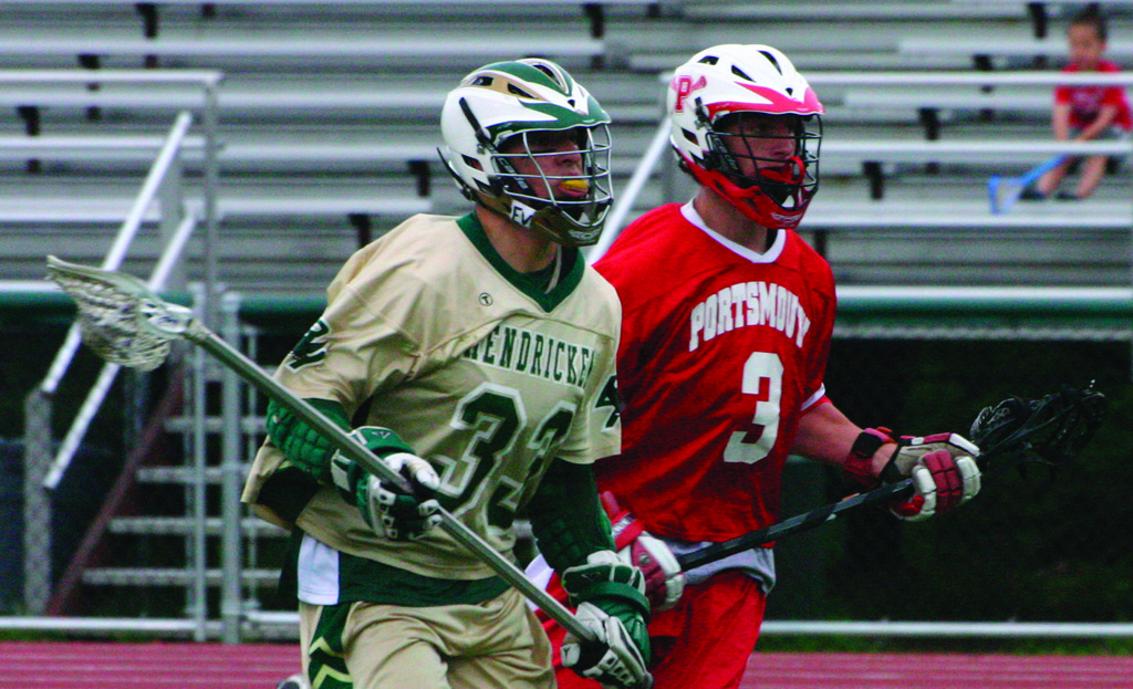 MOVING FORWARD: Hendricken's Mike Pecchia carries the ball across midfield in Monday's game.