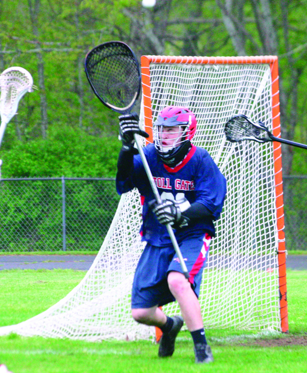IN POSITION: Toll Gate goalie Josh Giarrantano comes out of the goal to cut down the angle on a Narragansett shot during Tuesday's game with the Mariners.