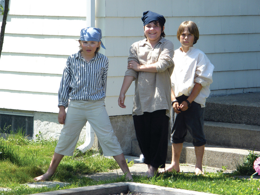 TAKEN PRISONER: Three scallywags prepare to defend themselves in a trial during a Walking Tour stop at the Jail House. They are, from left, Chase Greenlaw and Andrew Cavanaugh of the St. Peter School and Michael Blanchette of Wyman.