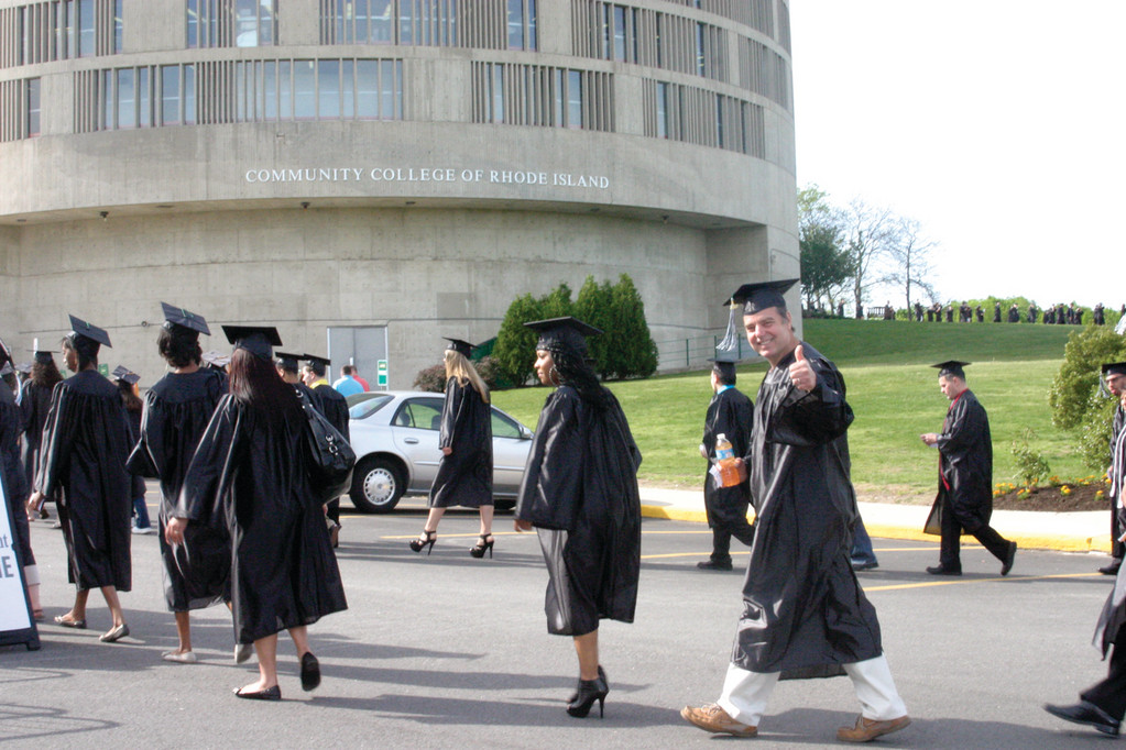THUMBS UP: The Community College of Rhode Island held its 47th commencement Friday, with 1,659 graduates earning degrees. Mike Kennedy, who received a diploma in business management, said he is thrilled to receive his second degree from the college to enhance his skills as an operating engineer.