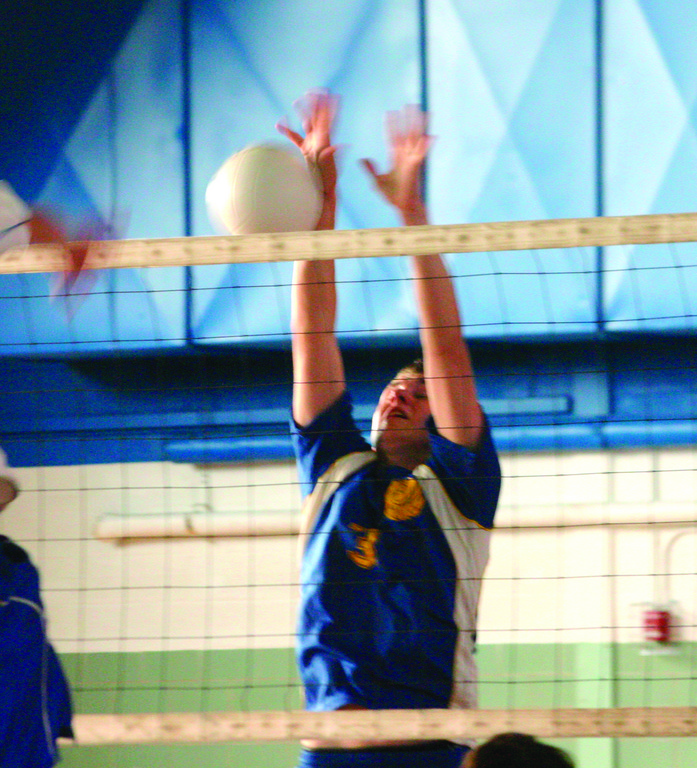 HANDS UP: Vets' Jacob McLinden rises for a block in last week's match against Scituate.