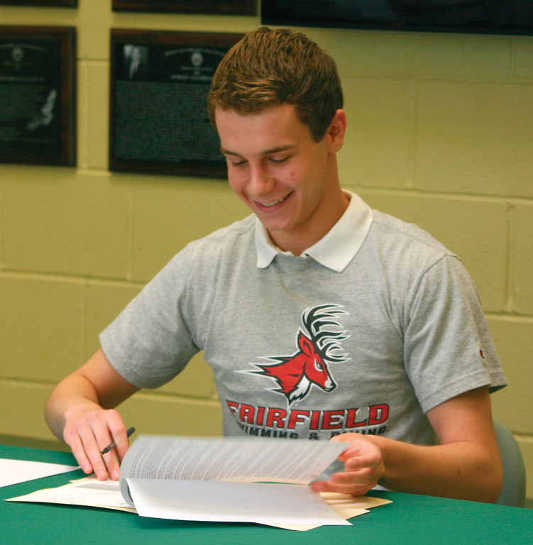 SIGNING ON: Hendricken's Andrew Robinson was all smiles as he committed to swim at Fairfield University.