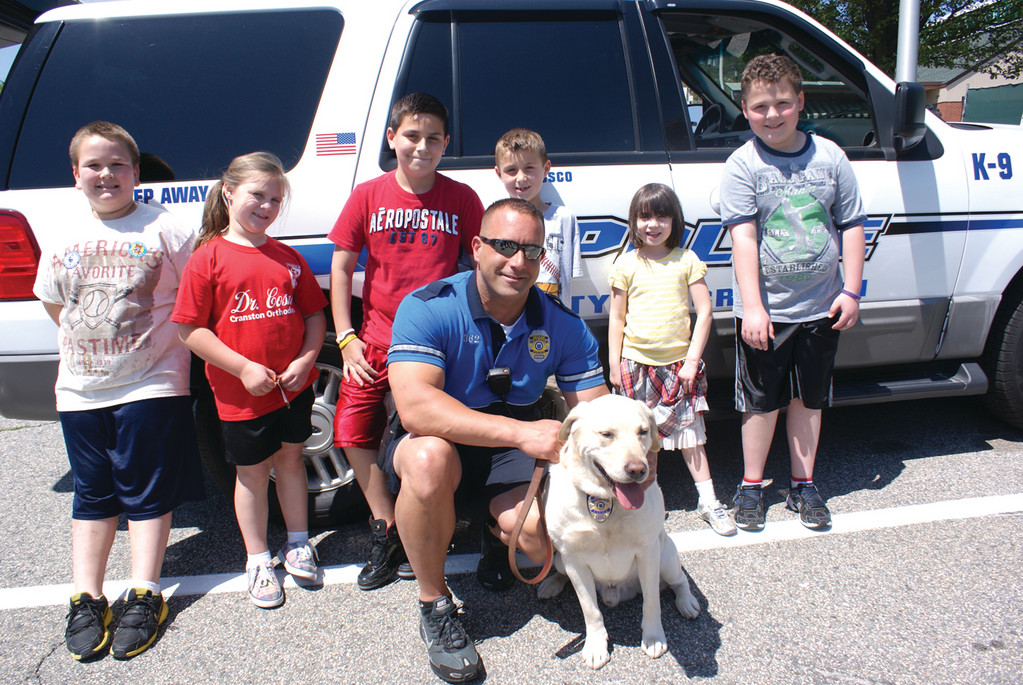 BOSCO AND BRUNO: Photographed with K-9 Officer Gregg Bruno and his Cranston K-9 partner, Bosco, are 9-year-old Anthony Messer, 8-year-old Hailey Davis, 10-year-old Mason Bruno, 7-year-old Caden Bruno, 5-year-old Lucy Hart and 9-year-old Joshua Dugan.
