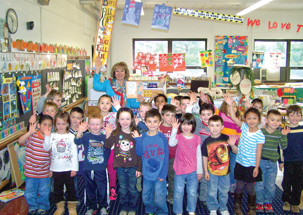 "LEARNING TO READ: Deb Mellion, the director of literacy for Cranston Public Schools, read ""Don't Let the Pigeon Drive the Bus"" as well as ""Alice the Fairy,"" to students in Bernadette Bowen's morning kindergarten class."
