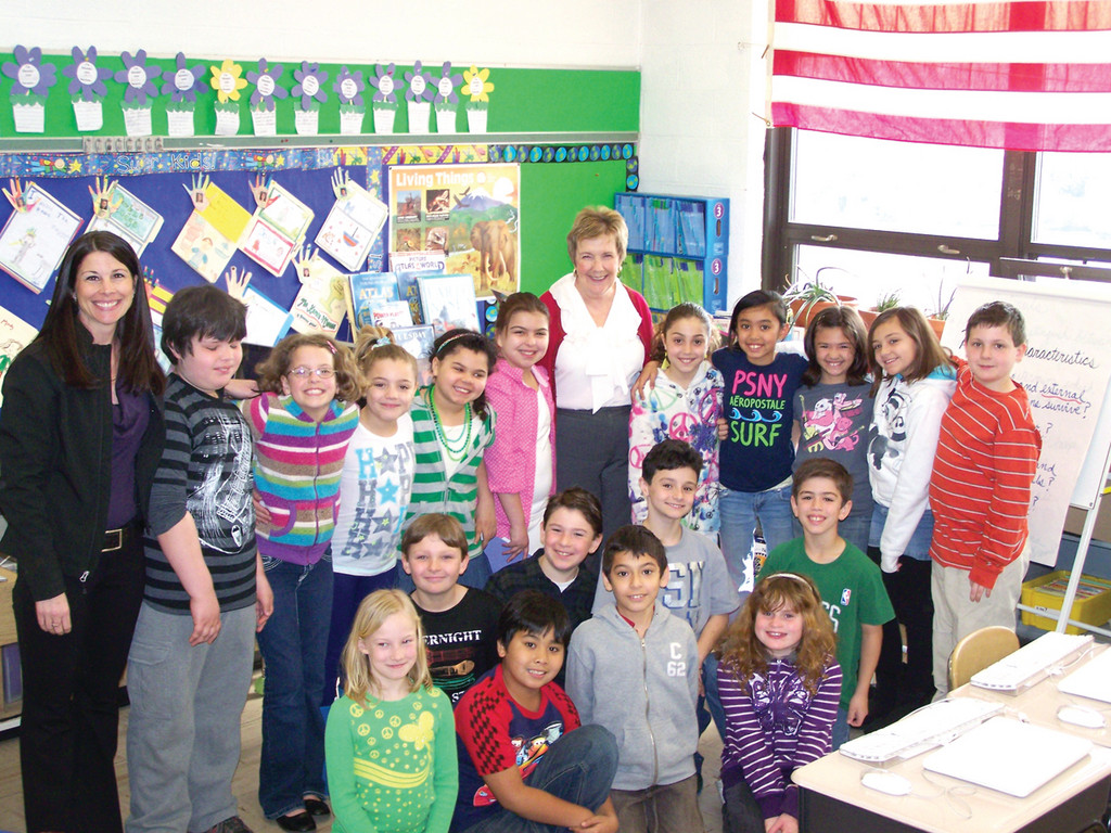 "FAIRY TALE DAY: Assistant Superintendent Dr. Judy Lundsten visited Lorinda Jackson and her third grade class at Woodridge for a reading of ""The True Story of the Three Little Pigs"" and ""The Giant and the Beanstalk."""