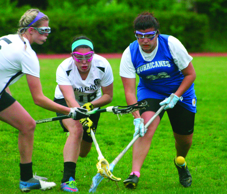 TANGLED: Pilgrim's Cara Beneduce and Hailey McCusker battle for possession of the ball with Vets' Bianca Capelli in Monday's season finale. Pilgrim won 15-9.