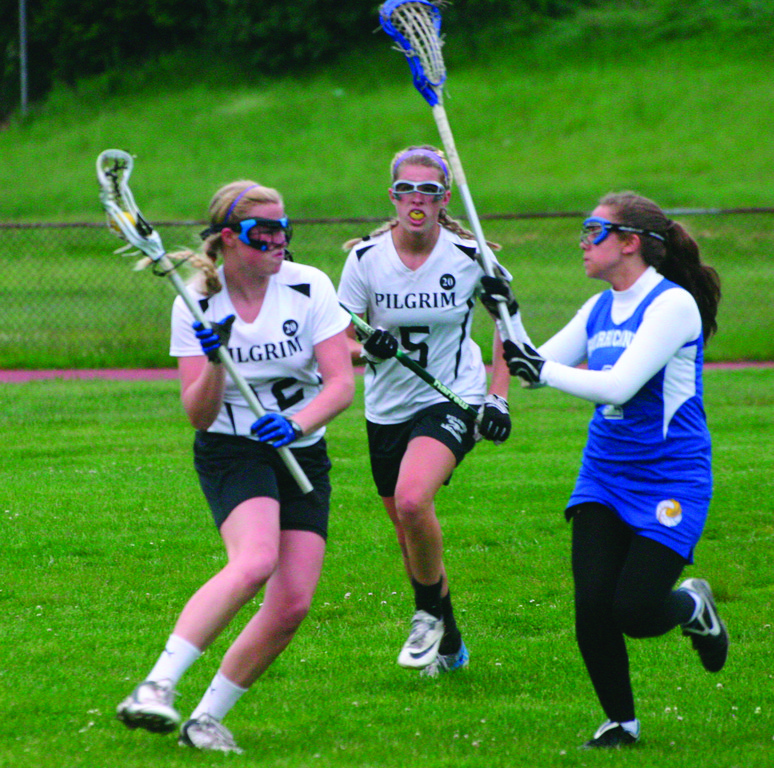 IN MOTION: Pilgrim's Betsy Heidel makes a move around Vets' Victoria Flynn on Monday.
