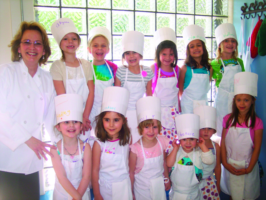 The smiling, joyful faces of Lindsay Cobb and her 6th birthday party guests at Petite Chef in Warwick.