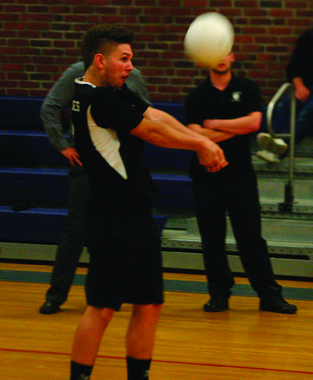 ON THE ARMS: Sean St. Jacques bumps the ball during Pilgrim's win over Scituate on Tuesday.