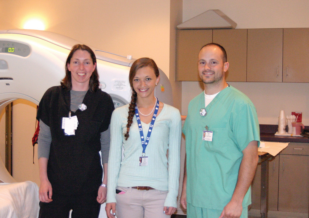 A LEARNING EXPERIENCE: Jessica Grasso (middle), a senior at St. Mary Academy Bay View, stands with Kerri Lauzon and Rob Amaral in the diagnostic imaging center. Grasso works at Kent Hospital every Wednesday for her internship as she rotates in-house. Each week she is in a new area in the hospital, and the imaging center has proved to be her favorite.