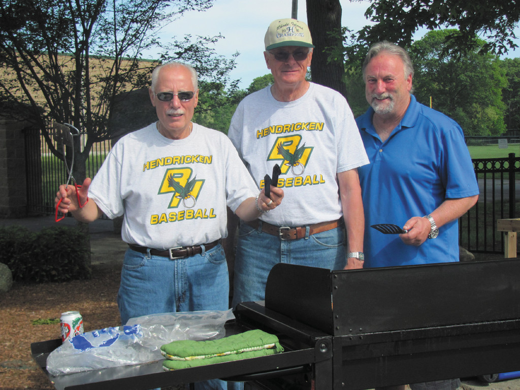 "A BREAK FROM GRILL DUTY: Mike Benedetto (left), a computer science tech teacher at Bishop Hendricken High, enjoys a lighter moment and break from the charcoal grill – with Bill Campbell and Ron Mosca during Sunday's 110-vehicle Car Show in Warwick. Benedetto and Mosca co-chaired the event while Campbell – a.k.a. ""Mr. DJ"" – played classic Doo-wop music."