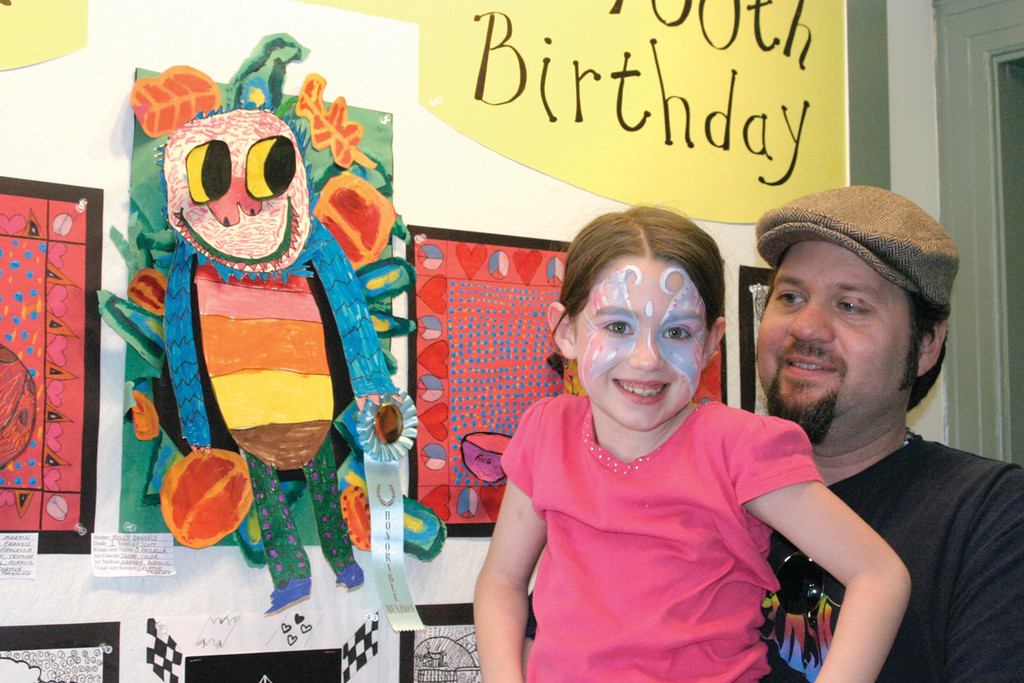 "WHERE THE WILD THINGS ARE: Using the classic 1963 children's book, ""Where the Wild Things Are,"" as an inspiration, Molly Daniels created a 3-D monster. Molly, who earned an honorable mention for her work of art, smiles with her father, Brad."