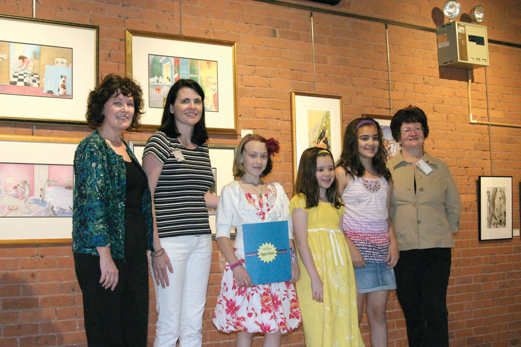 ASPIRING ARTISTS: The Warwick Museum of Art held an art contest for school children, results of which are showcased in the museum's new classroom. Museum Board Member Deb Mercer (left), Board President Michelle Place-Gleason and Program Director Patty Martucci (right) honored the winners Saturday, including August Allaire, Jacey Foshey and Jordan Petrucci.