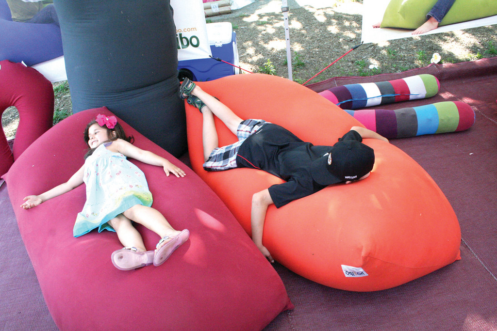 GREAT PLACE TO HANG OUT: The bean bag furniture of one vendor was too much of a temptation for some youngsters.