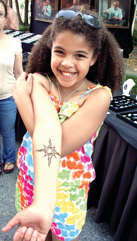 GOOD FOR A COUPLE DAYS: Kallie Mangun displays the tattoo she received on her visit to the fair Sunday afternoon.