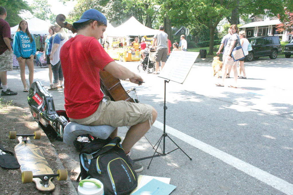 MUSIC MAKER: Cellist Sam Adamo, skateboard at the ready, entertained throughout the festival. He is seen here Monday morning.