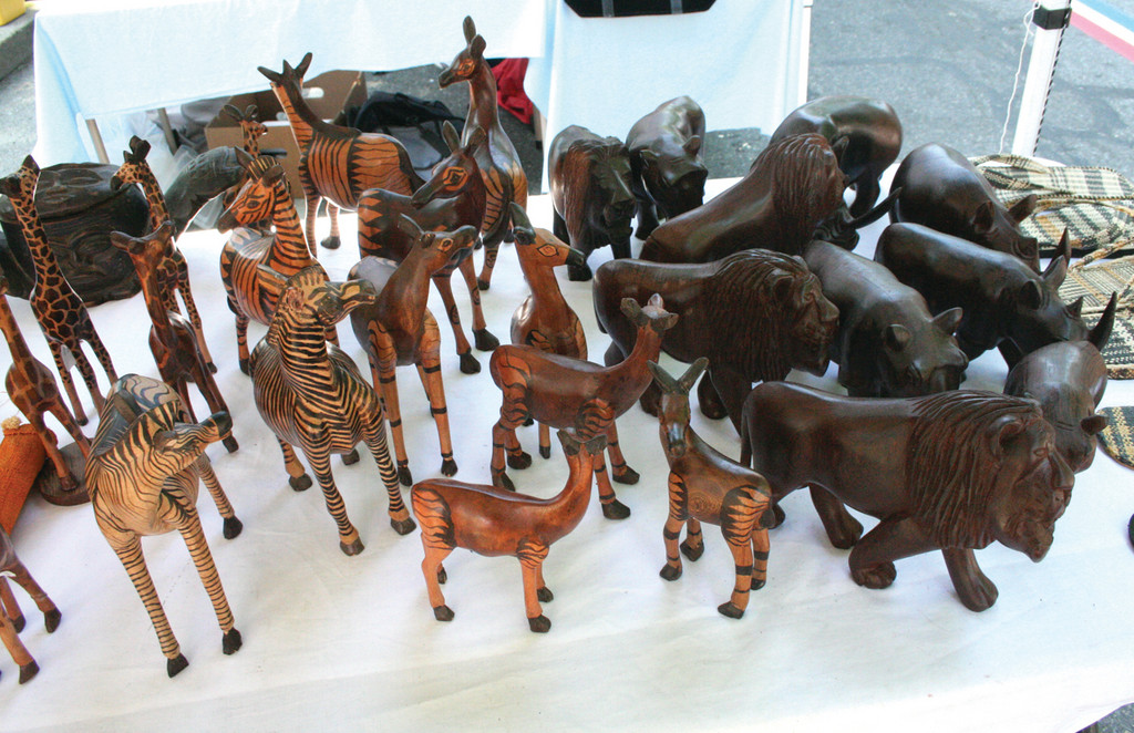 TABLETOP MENAGERIE: Carved in the Congo, this display of animals was one of many attractions. By Sunday, all of the elephants had been sold.