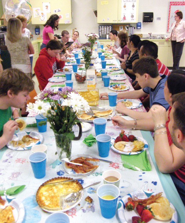 WHAT A SPREAD: A sprawling table of breakfast foods was set up in Christina Metelski's Growth Opportunities classroom at Toll Gate High School on Friday for their second annual May Breakfast. Students prepared the foods, which included bacon, quiche, pancakes and more. Parents attended to partake in the feast.