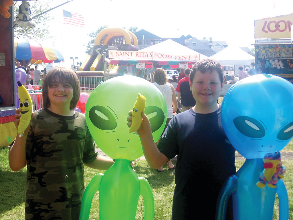 GOING BANANAS: Joe Tanzi, 12,(right) and his friend Christopher Sahagian, 12, both sixth graders at Warwick Neck School, hold up their prizes after a fun day at the carnival.