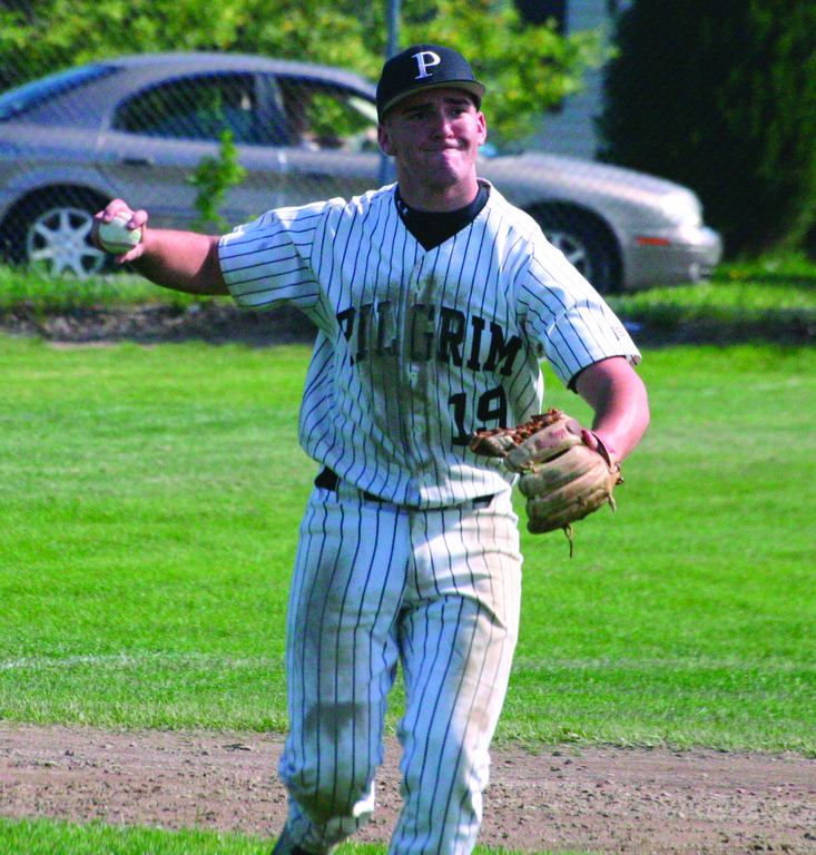 ON THE RUN: Pilgrim's Kevin Conway gets set to make a throw across the diamond last Wednesday.
