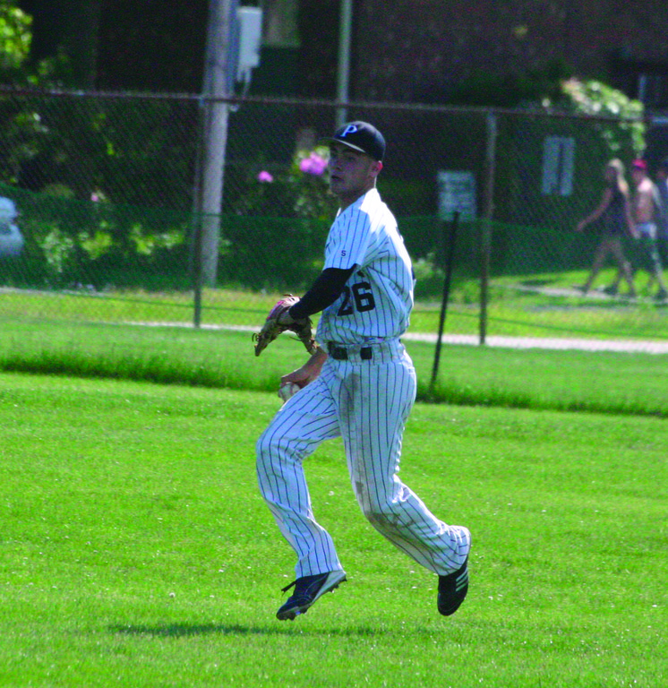 AT THE READY: Mike Mallozzi makes a throw from center field.