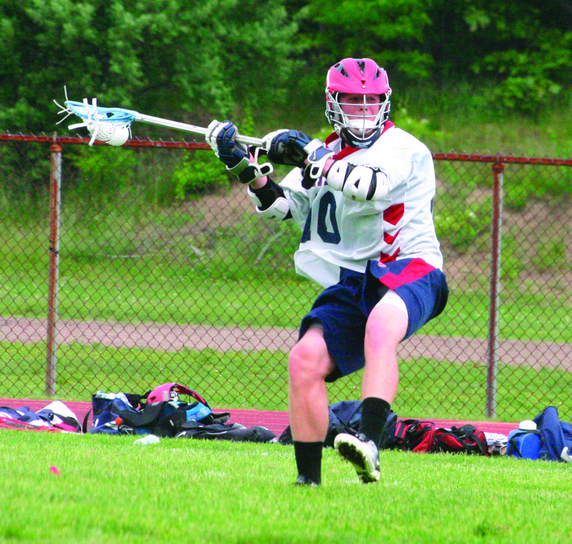 SLING IT: Toll Gate's Kyle Ellis lines up a big shot in Saturday's playoff game against Tiverton/Rogers. The Titans fell behind but then cruised to a victory and a berth in the semifinals.