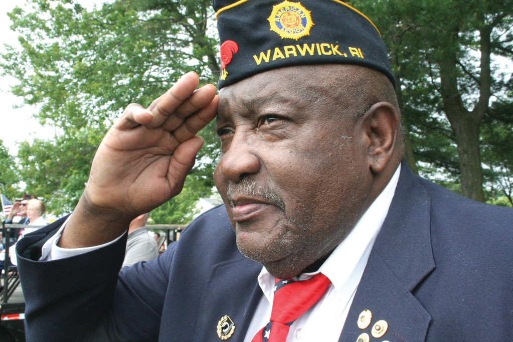 Fred Adams, who served in the Korean and Vietnam Wars and is president of the Warwick Veterans Council, salutes the flag in ceremonies following yesterday's parade.