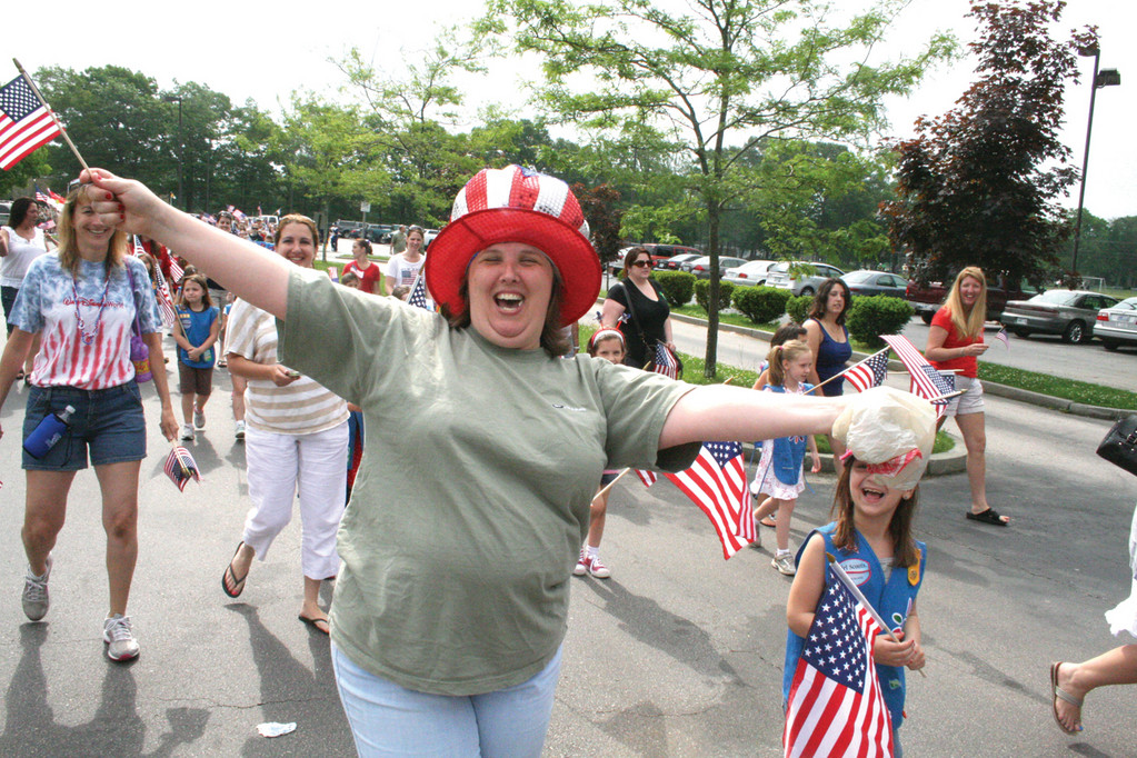 Maryann Martini started the parade that formed at Bishop Hendricken and followed a route ending at Vets High with an arms-open cheer.