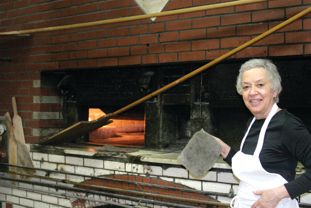 BRICK OVEN: Scialo Bros. co-owner Carol Gaeta takes pride in the fact that everything they sell is freshly baked in two brick ovens originally built in 1920.