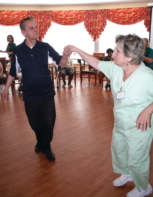 IN THE SPOTLIGHT: Dance Instructor Don Gillis cuts a rug with Activities Aide Geraldine Rave.