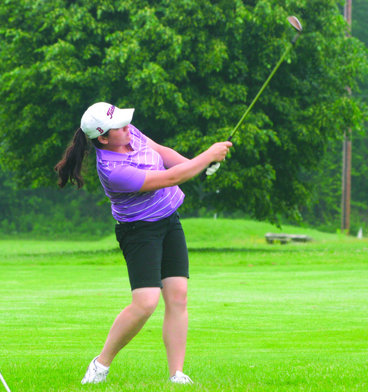 Pilgrim's Susie Cavanagh hits an approach shot from the rough on Tuesday.