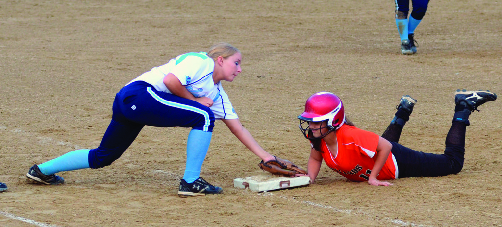 Lindsey Haskins puts down a tag at first base
