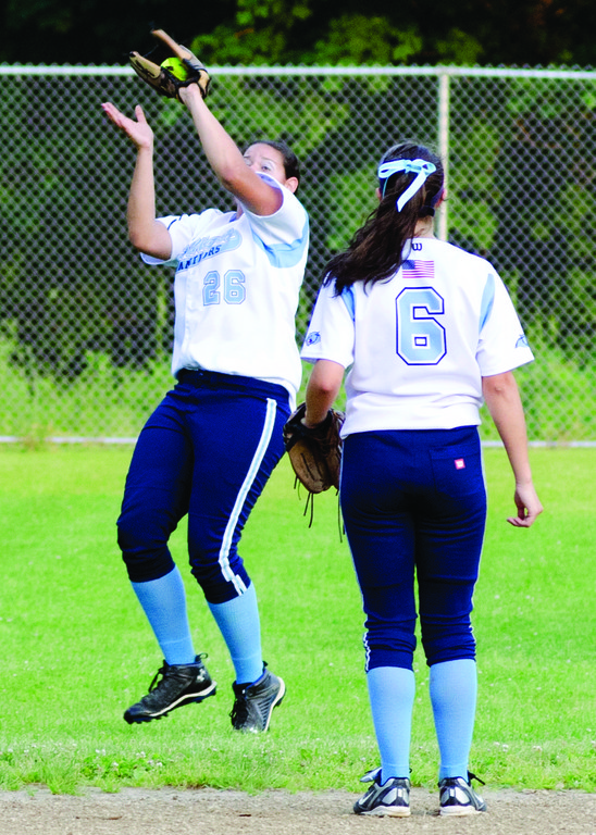 Ashley Peterson makes a catch in front of Danielle Gawlik.