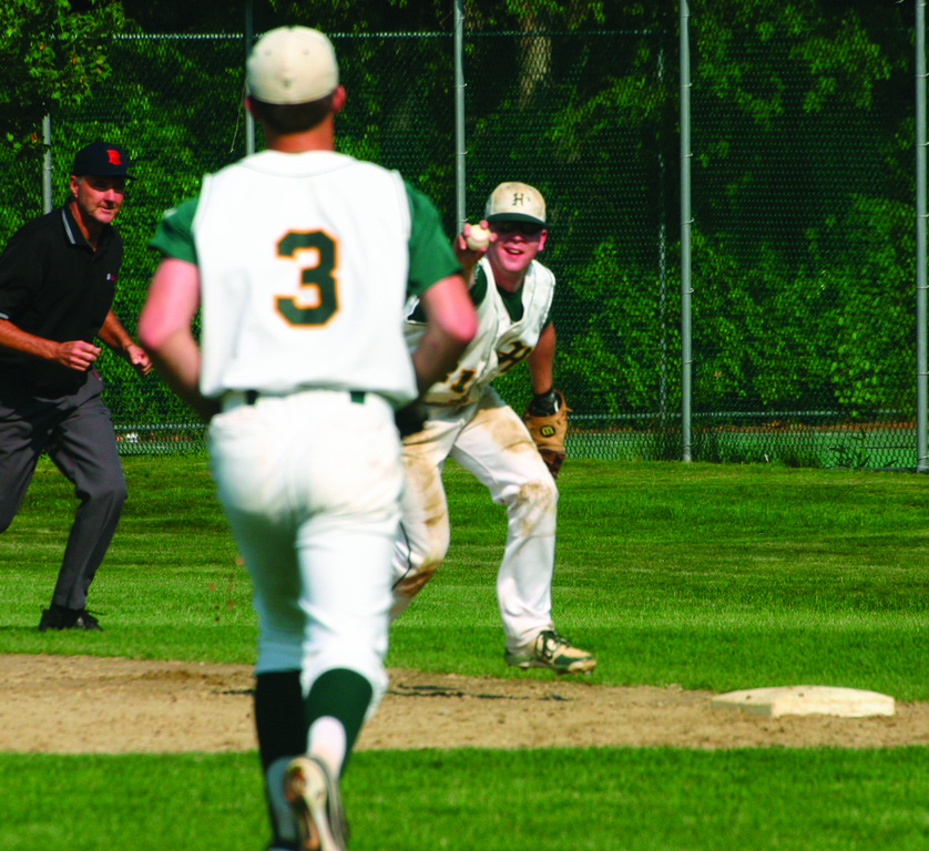 NICE JOB: Hendricken's P.J. Murray (right) points at pitcher Tom Pannone from first base after making a strong defensive play.