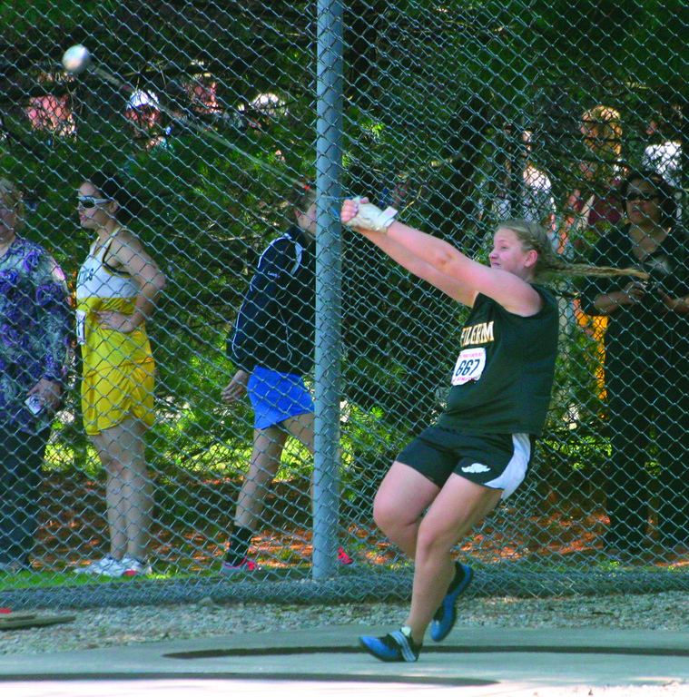 GOING OUT ON TOP: Pilgrim senior Maggie Dufault won the hammer throw for her first state title.