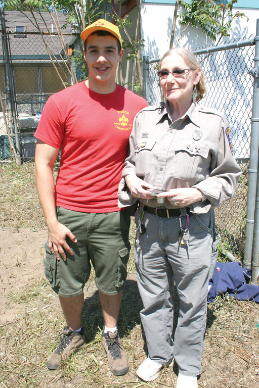 HAPPY TO HELP: Boy Scout Nick DeLuca is glad that his Eagle Scout project will benefit the Cranston Animal Shelter in his own community. Here, DeLuca stands with Pat Maxwell, one of the staff members at the shelter.