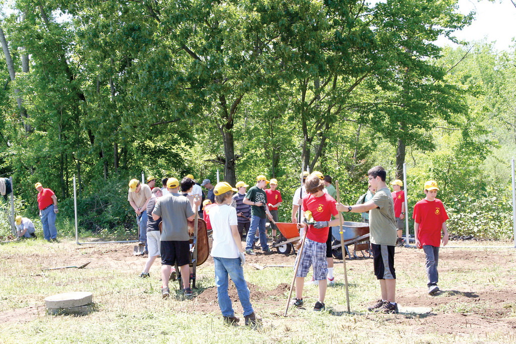 ALL HANDS ON DECK: Nick DeLuca had great weather and a great turnout on the day of his service project. The boys from Troop 6 Cranston came out in droves to help rake, shovel, dig and set the poles for the fencing that would create a new exercise and play yard for the animals at the shelter in Cranston.