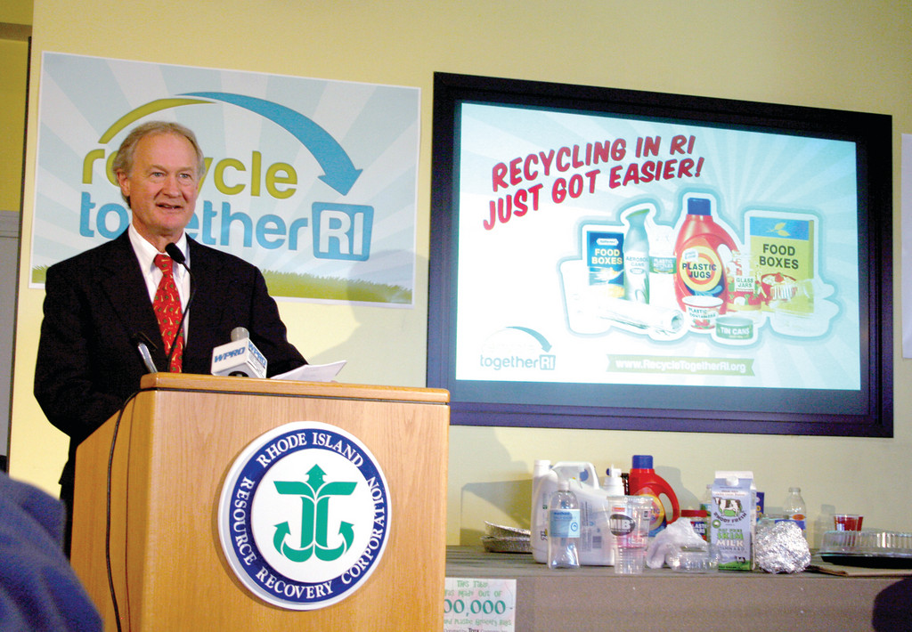 Governor Lincoln Chafee lauds the benefits of the state's new recycling system, and shows off some of the items that can now be recycled for the first time.