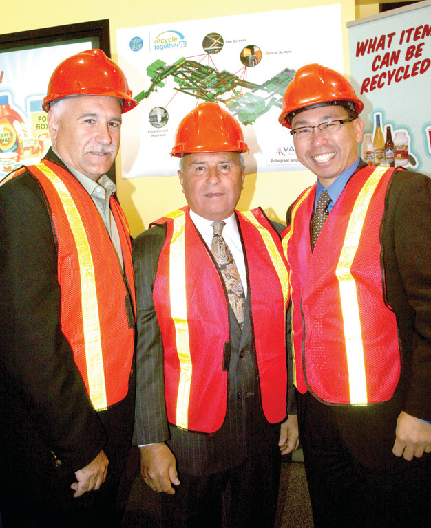 Johnston Mayor Joseph Polisena, North Providence Mayor Charles Lombardi and Cranston Mayor Allan Fung don hard hats to get ready for a tour of the recycling facility.