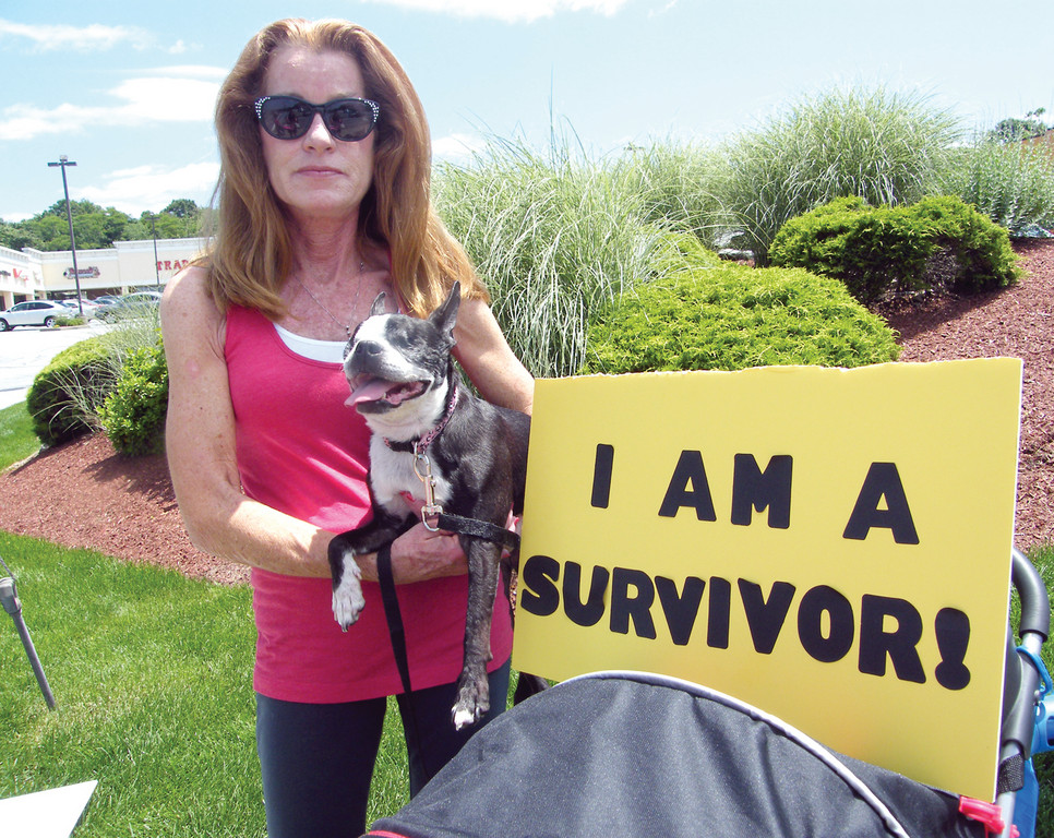 SHE SURVIVED: Kate Clark holds Chloe, a dog she rescued from a puppy mill in Missouri. Chloe�s eyes were so severely damaged that they had to be removed. Despite health problems that went untreated, Clark said Chloe was bred countless times at the puppy mill.