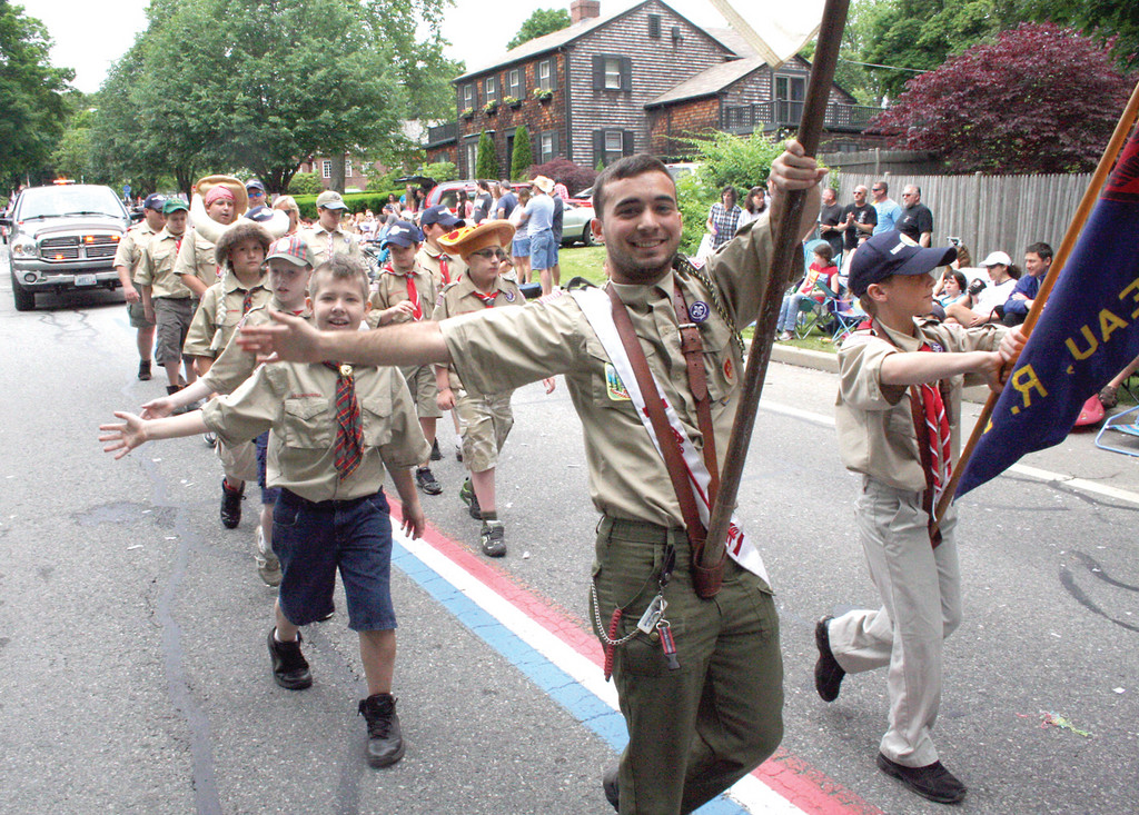 A WAVE OF SCOUTS: There were lots of scouts in the parade, including this troop frm Gaspee.