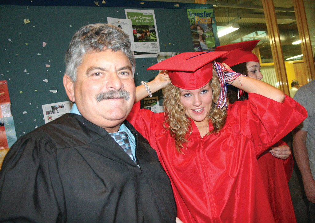 Wickes School principal Roy Costa and Amber Rich, who was a student at Wickes. She plans to pursue a career in nursing.