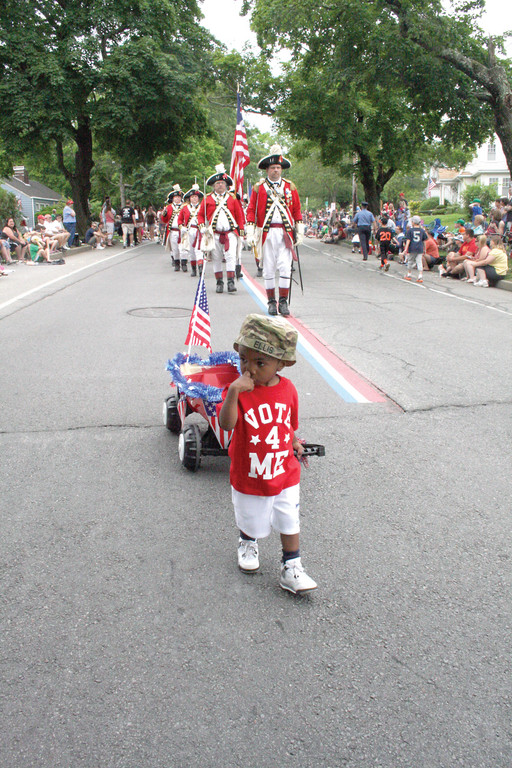 IN THE LEAD: Two-year-old Donovan Ellis, dressed in fatigues and pulling a wagon, was the vanguard to the Pawtuxet Rangers for a short time in Saturday's parade.