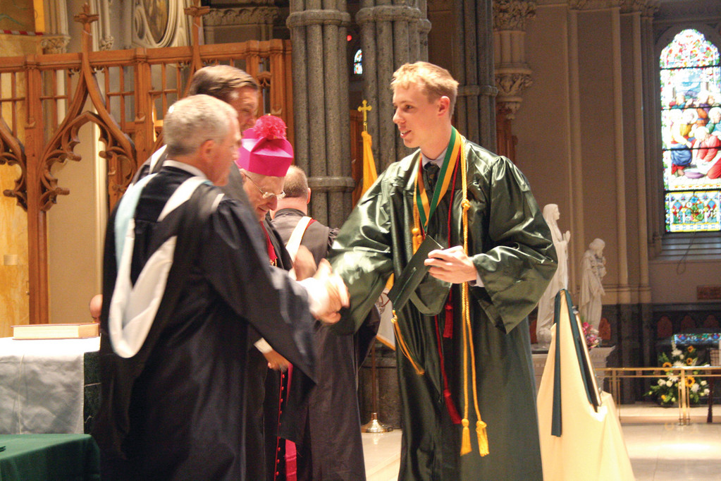 MAN OF MANY ACCOMPLISHMENTS: John P. Kane, class Valedictorian, received medals in theology and for general excellence.