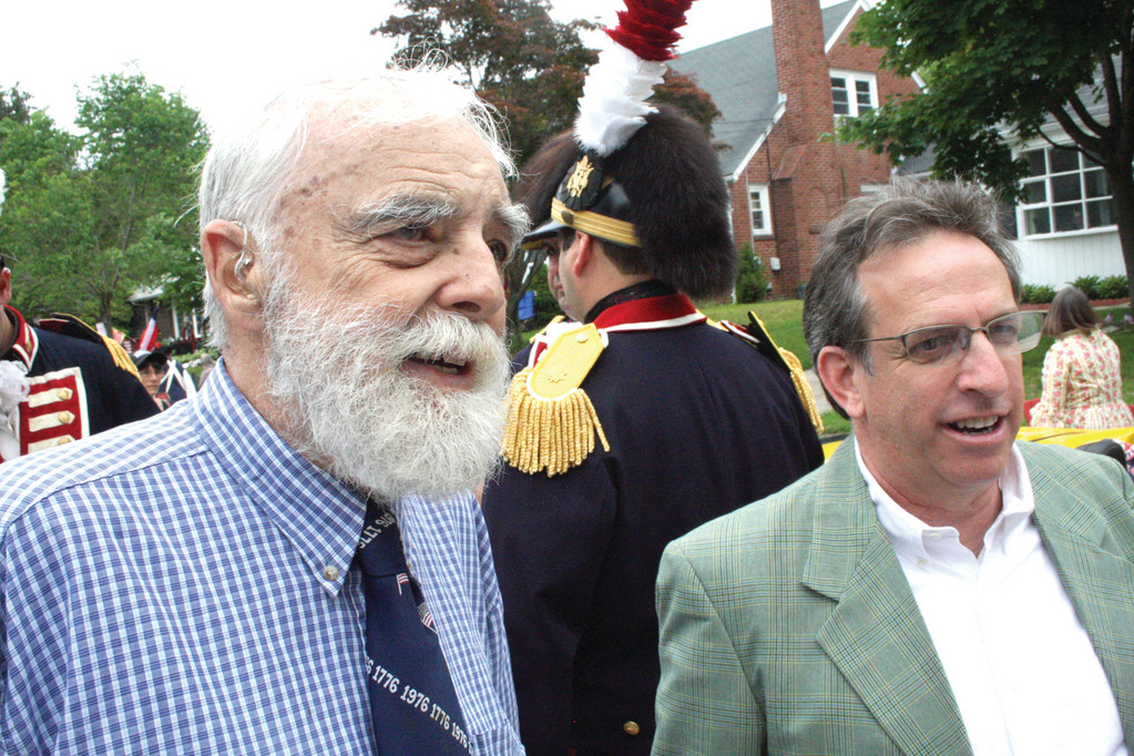 ONE OF THE FOUNDERS: Henry Brown, who was one of several to attend the first meeting of a group that went on to become the Gaspee Days Committee, talks with Cranston Senator Josh Miller.