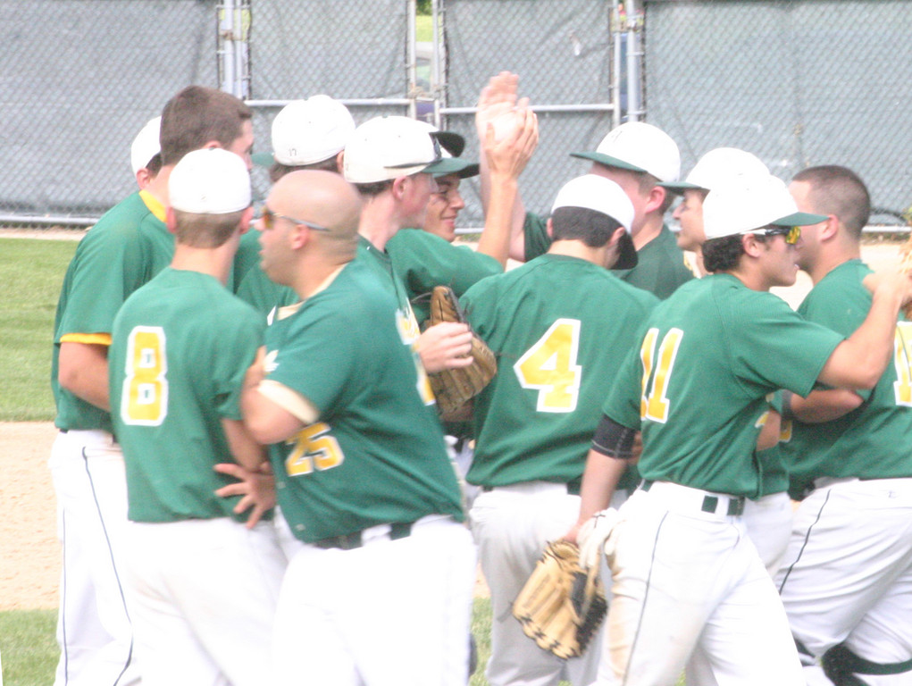 ON THEIR WAY: The Hendricken baseball team celebrates after the final out of Sunday's game in the semifinals. The Hawks won the dramatic game in 10 innings to clinch a berth in the state championship series.