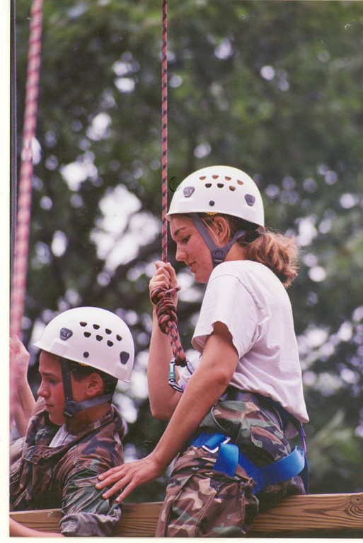 Katie Cahoon, now a sixth grade science teacher, remembers her Adventure Camp experiences fondly.  Here Cahoon, at approximately age 16, navigates a ropes course.