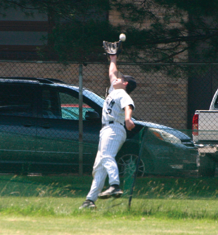 OUT OF ROOM: Pilgrim's Brett Ferguson makes an attempt at catching what turned out to be a home run by T.J. Lynch on Friday.