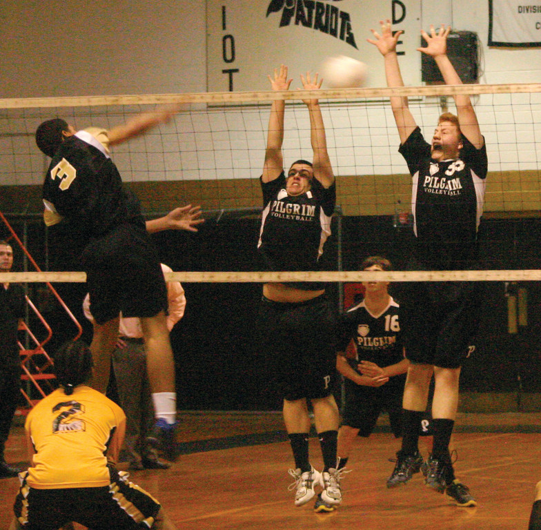 UP IN THE AIR: Jason Ferguson and Dan Colabella leap in the air for a block against Central.