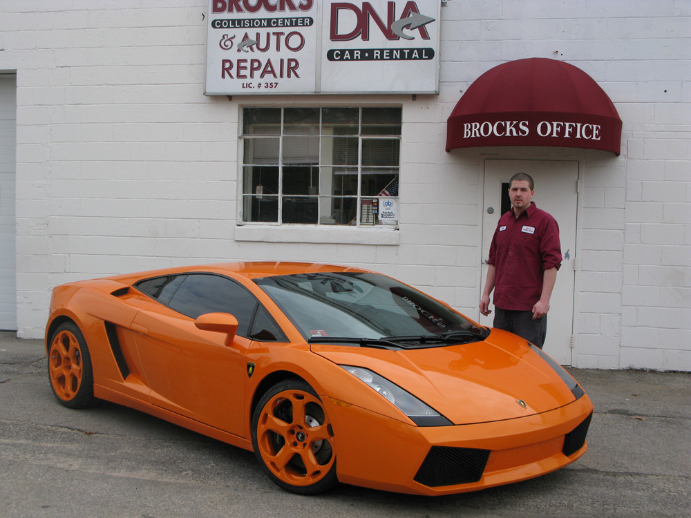 Technician Mike Thoin showcases one of Brock's Collision's prized repairs, this shining 2004 luxury Lamborghini.
